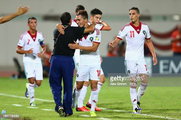 Hamza Sakhi of Morocco celebrates his team's third goal with head coach Abdellah El Idrissi during the FIFA U17 World Cup UAE 2013 Group C match...
