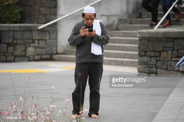 Hamzah Noor Yahaya a survivor of the shootings at Al Noor mosque stands in front of Christchurch Hospital at the end of a lockdown and waits to be...