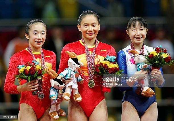 Han Bing of China Zhang Nan of China and Miki Uemura of Japan pose on the podium with their medals in the balance beam after the Artistic Gymnastics...