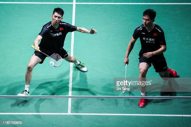 Han Chengkai and Zhou Haodong of China compete in the Men's Doubles first round match against Mark Lamsfuss and Marvin Seidel of Germany on day one...