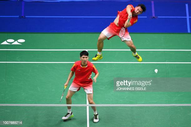 Han Chengkai of China hits a shot past teammate Zhou Haodong against Milosz Bochat and Adam Cwalina of Poland in their men's doubles match during the...