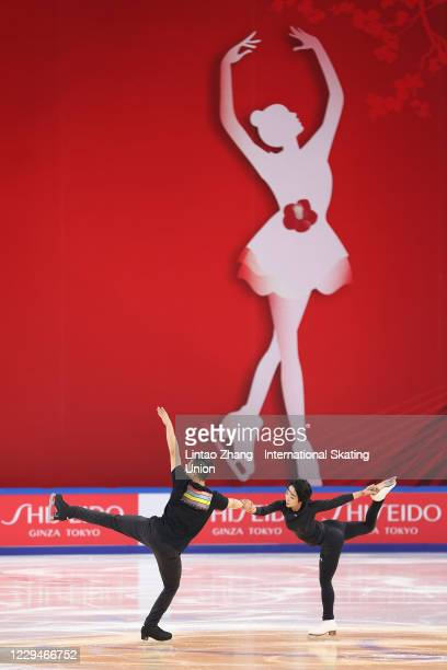 Han Cong and Sui Wenjing of China participate in pre-match training ahead of the ISU Grand Prix of Figure Skating Cup of China at Huaxi Sports Center...