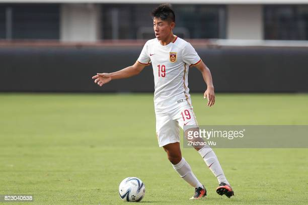 """Han Dong of China controls the ball during 2017""""CEFC CUP""""Jinshan International Youth Football Tournament between China 2024 Olympic Hope Team A v..."""