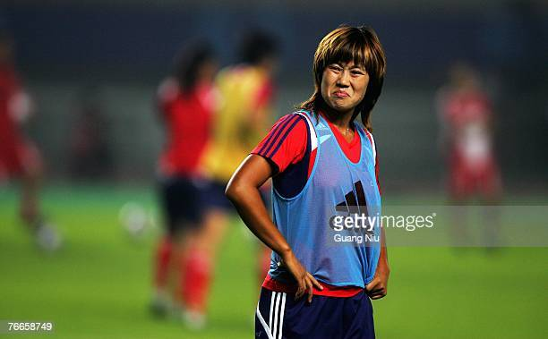 Han Duan of China attends a training session for the FIFA 2007 World Cup in China at Wuhan Sports Center Stadium on September 11, 2007 in Wuhan,...