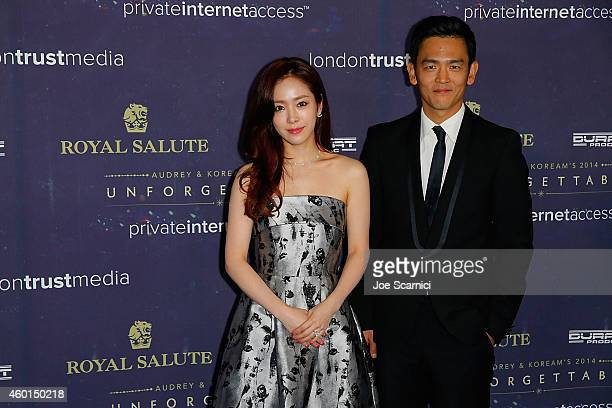 Han Ji Min and John Cho arrive at the 2014 Unforgettable Awards presented by Royal Salute at the Park Plaza Hotel on December 5 2014 in Los Angeles...
