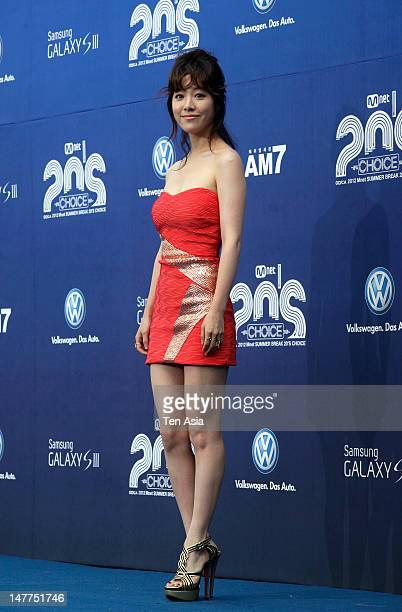 Han JiMin poses for photographs upon arrival during 2012 Mnet Summer Break 20's Choice at Banyan Tree Club Spa Seoul on June 28 2012 in Seoul South...