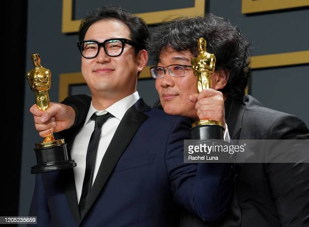 Han Jinwon and Bong Joonho winners of the Original Screenplay award for Parasite pose in the press room during the 92nd Annual Academy Awards at...