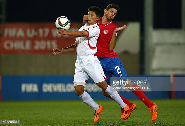 Han Kwang Song of Korea DPR and Diego Mesen of Costa Rica vie for the ball during the Costa Rica v Korea DPR Group E FIFA U17 World Cup Chile 2015...
