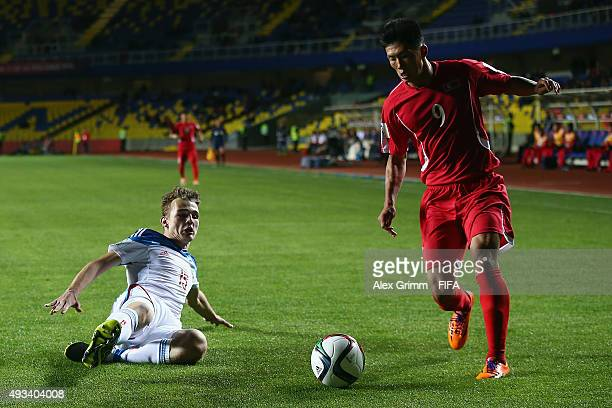 Han Kwang Song of Korea DPR is challenged by Semen Matviichuk of Russia during the FIFA U17 World Cup Chile 2015 Group E match between Korea DPR and...