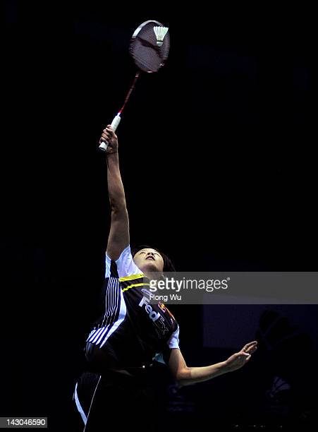 Han Li of China plays a shot during her match against Nozomi Okuhara of Japan during day Two of the 2012 Badminton Asia Championships at Qingdao...