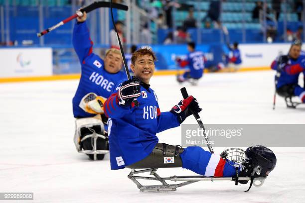 Han Minsu of South Korea celebrates after the Ice Hockey Preliminary Group B match between South Korean and Japan during day one of the PyeongChang...