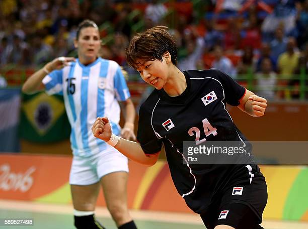 Han Na Gwon of Korea celebrates her goal as Antonela Mena of Argentina looks on on Day 9 of the Rio 2016 Olympic Games at the Future Arena on August...