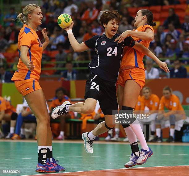 Han Na Gwon of Korea is challenged by Yvette Broch of Netherlands during the Womens Preliminary Group A match between Norway and Angola at Future...