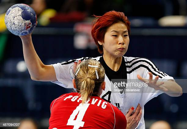 Han Na Gwon of South Korea in action against Jelena Popovic of Serbia during the 2013 World Women's Handball Championship 2013 match between South...