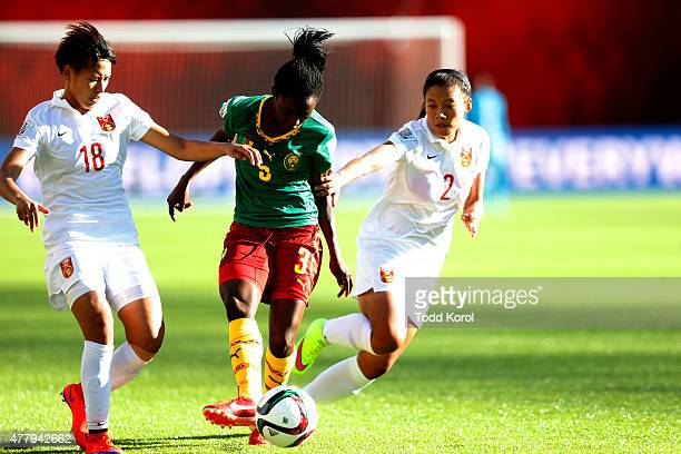 Han Peng and Liu Shanshan of China try to block Ajara Nchout of Cameroon during the FIFA Women's World Cup Canada Round 16 match between China and...