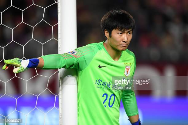 Han Rong Ze of Shandong Luneng gestures during the AFC Champions League Group E match between Kashima Antlers and Shandong Luneng at Kashima Soccer...