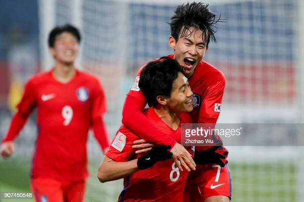 Han Seunggyu of South Korea celebrates his scoring with teammates during AFC U23 Championship Quarterfinal between South Korea and Malaysia at...