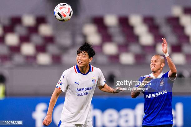 Han Suk Jong of Suwon Samsung defends the ball from Marcos Santos of Yokohama Marinos during the AFC Champions League Round of 16 match between...
