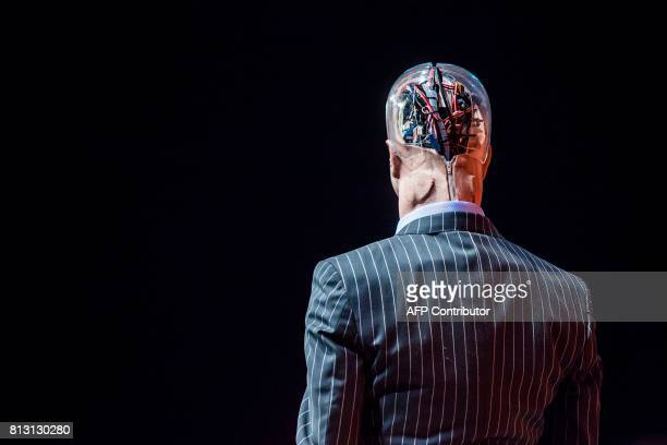 TOPSHOT 'Han the Robot' waits on stage before a discussion about the future of humanity in a demonstration of artificial intelligence by Hanson...
