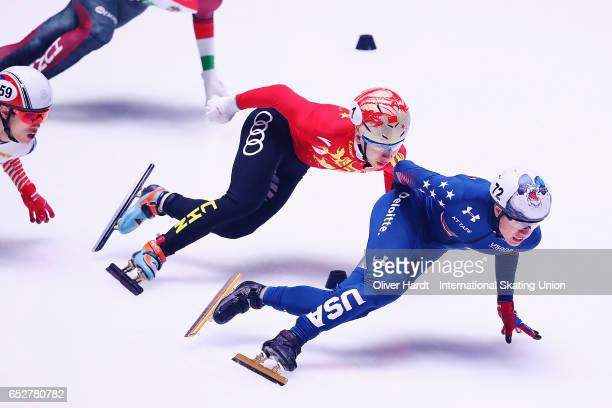 Han Tianyu of China and J R Celski United States of America competes in the Men«s 1000m quarter finals race during day two of ISU World Short Track...