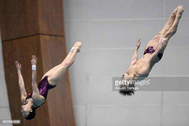Han Wang and Zheng Li of China compete in the Mixed 3m Synchro Springboard final during day three of the FINA Diving World Series Fuji at Shizuoka...