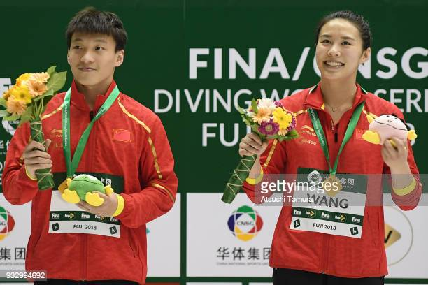 Han Wang and Zheng Li of China pose with their medals after the Mixed 3m Synchro Springboard final during day three of the FINA Diving World Series...