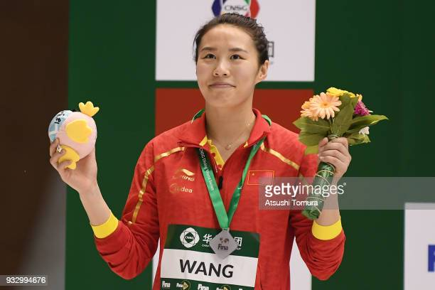 Han Wang of China smiles with her silver medal after the Women's 3m Springboard final during day three of the FINA Diving World Series Fuji at...