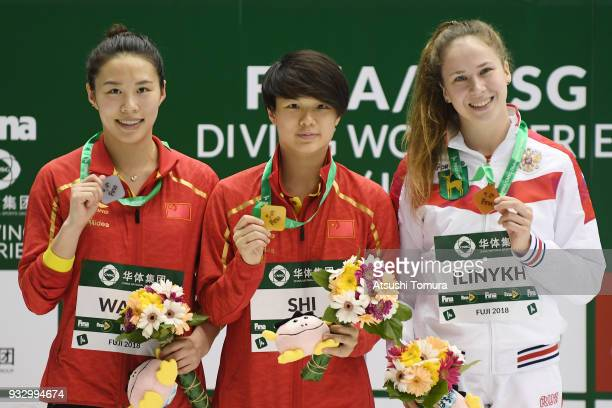 Han Wang of China Tingmao Shi of China and Kristina Ilinykh of Russia pose on the podium after the Women's 3m Springboard final during day three of...