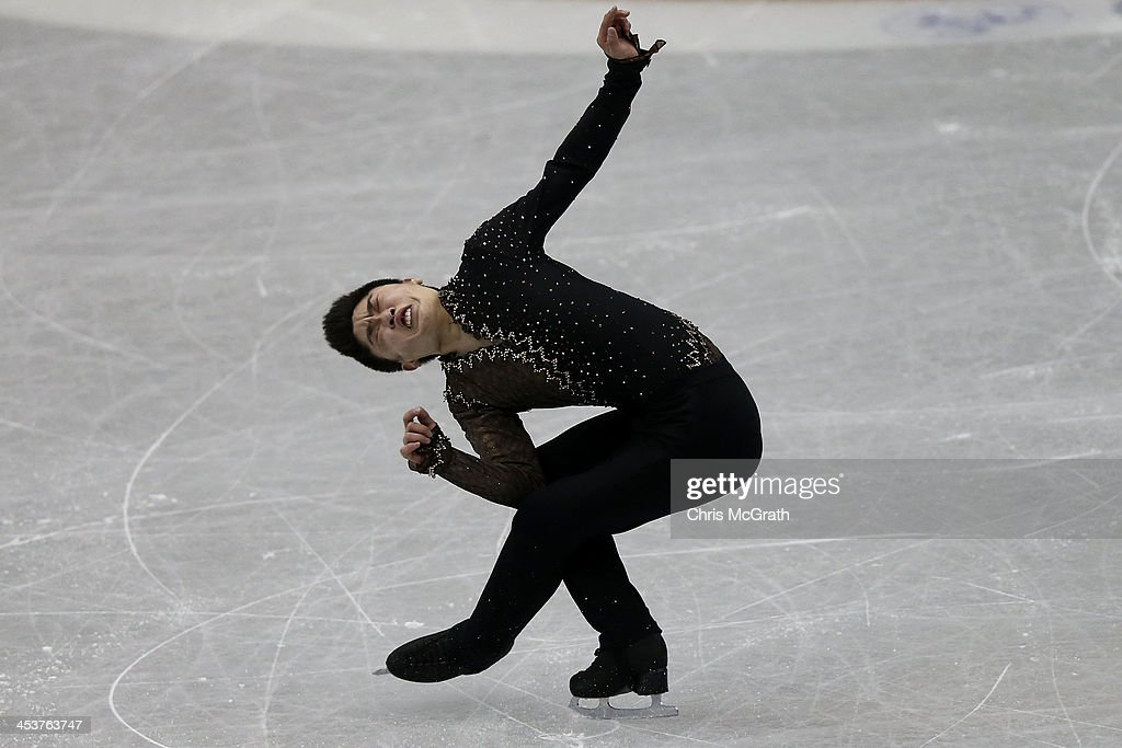 Han Yan of China competes in the Men's Short Program during day one of the ISU Grand Prix of Figure Skating Final 2013/2014 at Marine Messe Fukuoka on December 5, 2013 in Fukuoka, Japan.