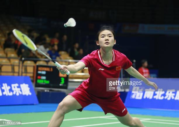 Han Yue of China hits a return against Saina Nehwal of India during their women's singles first round match at the 2019 Badminton Asia Championships...
