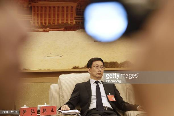 Han Zheng, Chinese Communist Party secretary of Shanghai, attends a delegation meeting at the Great Hall of the People during the 19th National...