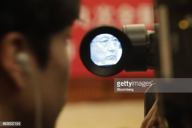 Han Zheng, Chinese Communist Party secretary of Shanghai, is seen in a camera viewfinder at a delegation meeting at the Great Hall of the People...