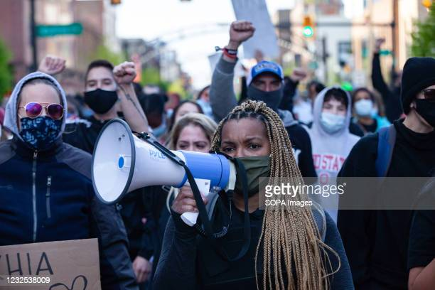 Hana Abdur-Rahim, a local organizer, leads Black Lives Matter activists in a march back to Goodale Park during a protest against the police killing...