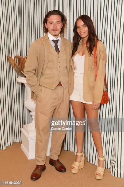 Hana Cross and Brooklyn Beckham in Polo Ralph Lauren attend the Polo Ralph Lauren suite during the Wimbledon Tennis Championship Men's Final at All...