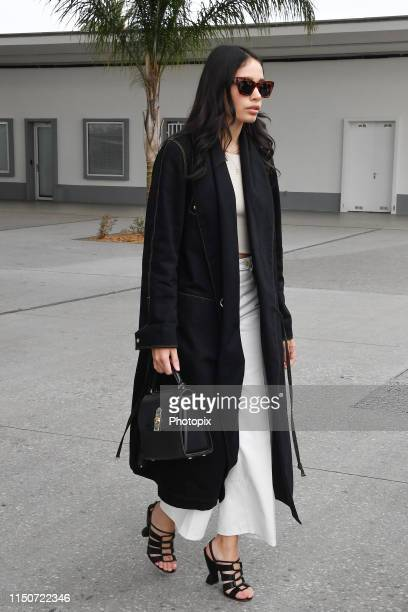 Hana Cross arrives ahead of the 72nd annual Cannes Film Festival at Nice Airport on May 21 2019 in Nice France