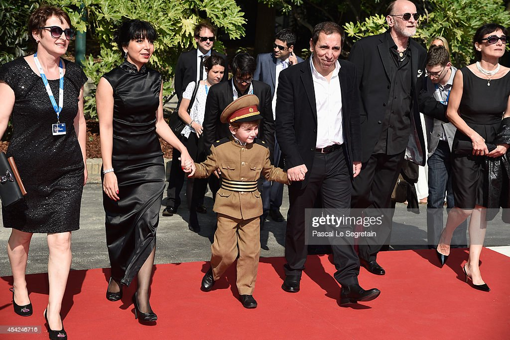 Hana Makhmalbaf, actor Dachi Orvelashvili, director Mohsen Makhmalbaf and Misha Gomiashvili attend the 'The President' premiere during the 71st Venice Film Festival on August 27, 2014 in Venice, Italy.