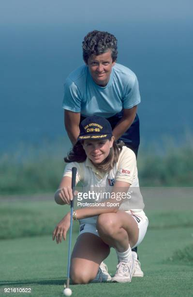 Hana Mandlikova of Czechoslovakia and her coach Betty Stove pose together whilst playing golf during the Eastbourne Tennis Championships circa June...
