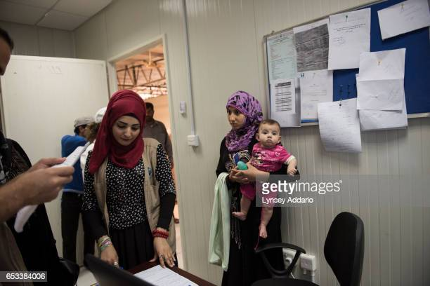 Hana Mufleh Mohammed a Syrian refugee from Daraa goes to the hospital run by JHAS and UNHCR to get a referral for a neurologist to diagnose the root...