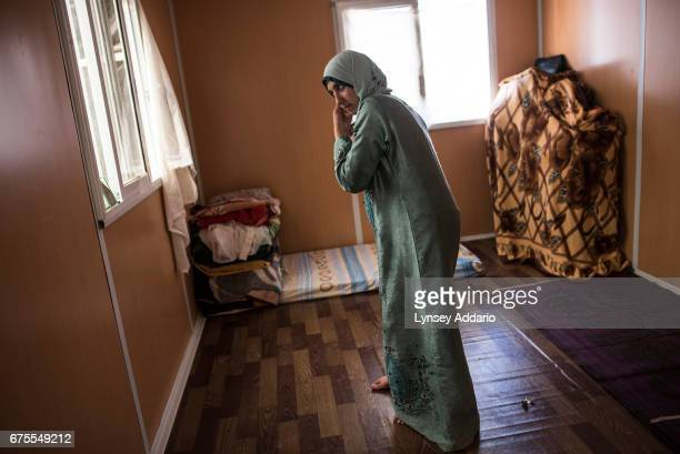 Hana Mufleh Mohammed a Syrian refugee from Daraa prepares to go out to the clinic run by JHAS and the United Nations Population Fund at the Zaatari...