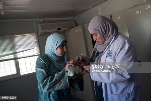 Hana Mufleh Mohammed a Syrian refugee from Daraa speaks with Dr Reema Diab at a clinic run by JHAS and the United Nations Population Fund at the...
