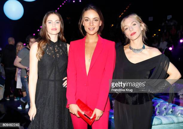 Hana Nitsche, Janina Uhse and Julia Dietze attend the Guido Maria Kretschmer Fashion Show Autumn/Winter 2017 presented by OTTO at Tempodrom on July...