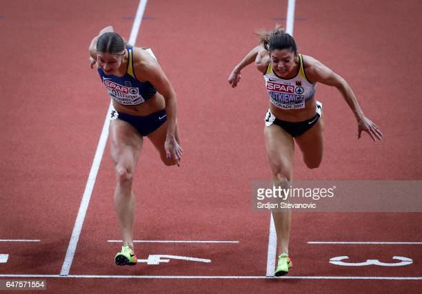 Hana Plotitsyna of Ukraine and Pamela Dutkiewicz of Germany competes in the Women's 60 metres hurdles final on day one of the 2017 European Athletics...