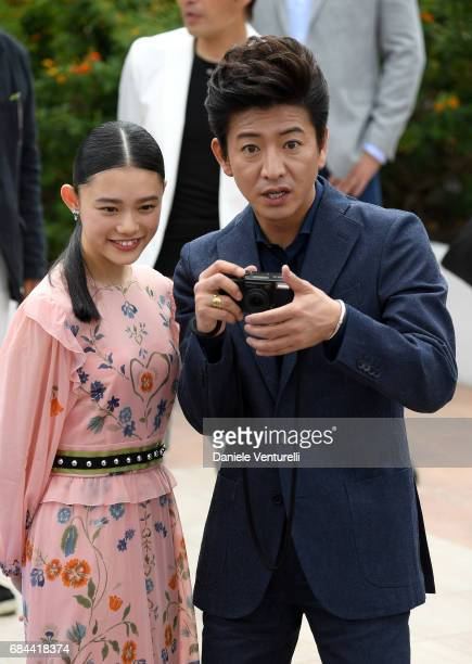 Hana Sugisaki and Takuya Kimura attend the 'Blade Of The Immortal ' photocall during the 70th annual Cannes Film Festival at Palais des Festivals on...