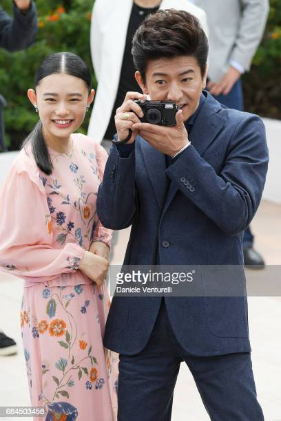 Hana Sugisaki and Takuya Kimura attend the Blade Of The Immortal photocall during the 70th annual Cannes Film Festival at Palais des Festivals on May...