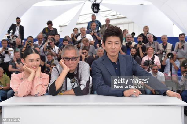 Hana Sugisaki Takashi Miike and Takuya Kimura attend the 'Blade Of The Immortal ' photocall during the 70th annual Cannes Film Festival at Palais des...