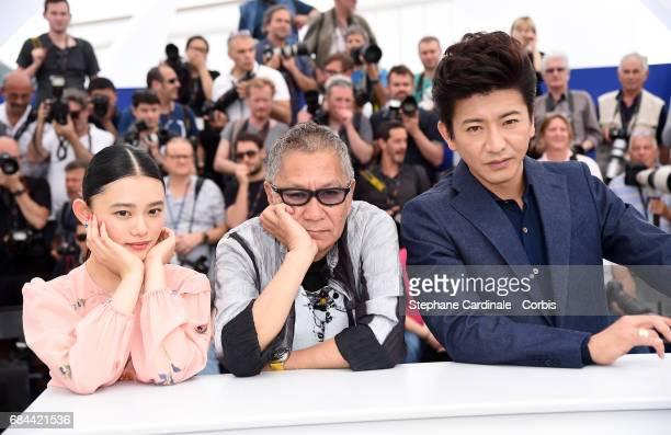 Hana Sugisaki Takashi Miike and Takuya Kimura attend the 'Blade Of The Immortal ' photocall during the 70th annual Cannes Film Festival at Palais des...