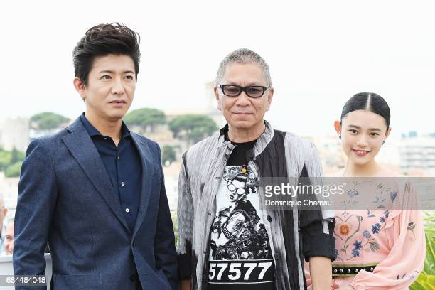 Hana Sugisaki Takashi Miike and Takuya Kimura attend the Blade Of The Immortal photocall during the 70th annual Cannes Film Festival at Palais des...