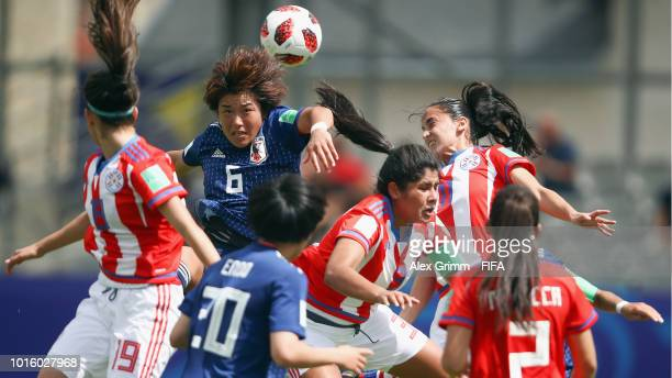 Hana Takahashi of Japan jumps for a header with Lorena Alonso and Lice Chamorro of Paraguay during the FIFA U20 Women's World Cup France 2018 group C...