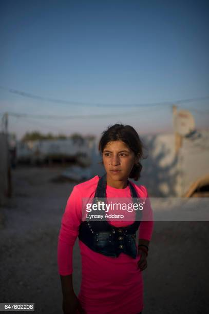 Hanaa Abdullah poses for a portrait in the informal tented settlement she lives in with her family and other Syrian refugeesin the Bekaa Valley...