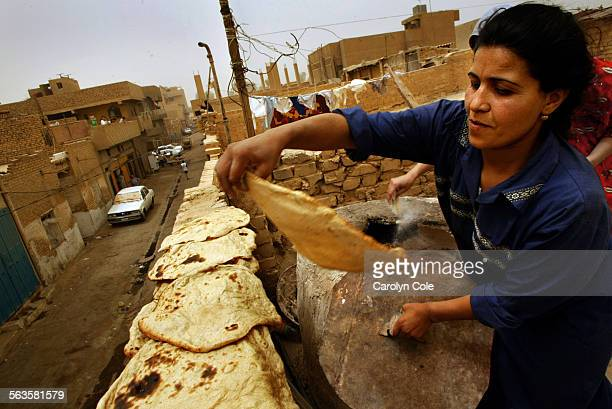 Hanaan Kadhim bakes bread for her family of 10 including 8 children in a cement oven on the roof She used to use a gas ballon to heat the oven but...